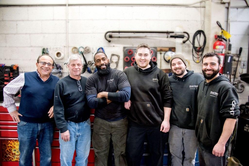 good-news-garage-staff-mechanics-workbench